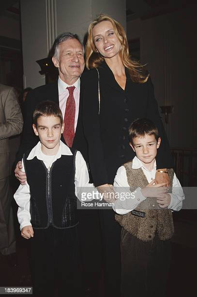 American magazine publisher Hugh Hefner with his wife American model and actress Kimberley Conrad and their two sons Marston Glenn Hefner and Cooper...