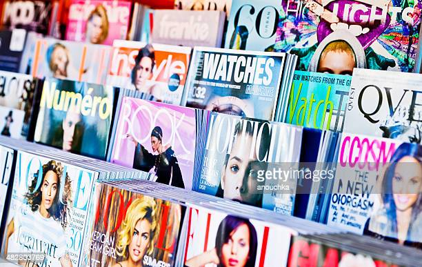 american magazines displayed for sale on newsstand - magazine stock pictures, royalty-free photos & images