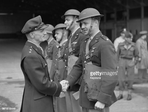 American MajorGeneral Carl Andrew Spaatz commander of the US Army Air Forces in Europe during World War II decorates the crew of a Boston bomber...