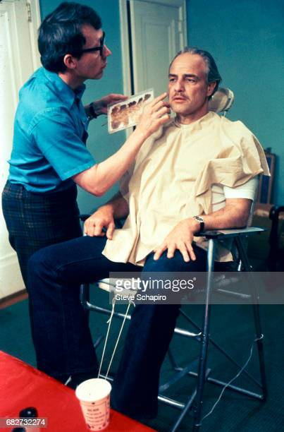 American makeup artist Dick Smith works on actor Marlon Brando to prepare for the latter's role in the film 'The Godfather' 1972