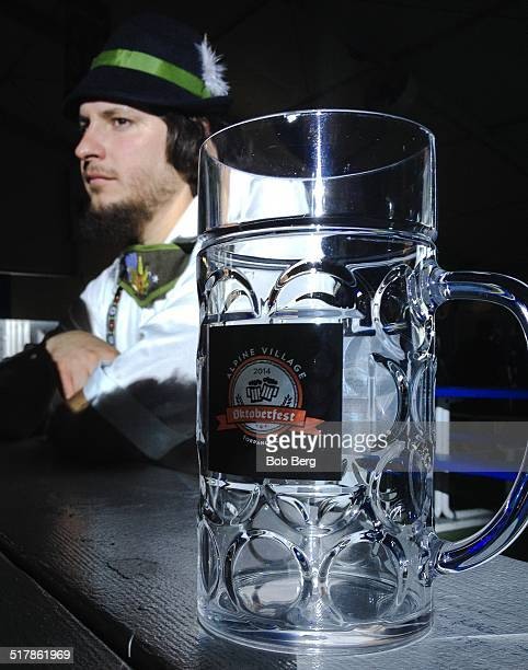 American male dressed in a traditional Bavarian garb eyes his empty commemorative beer mug at an Octoberfest celebration in Torrence Ca