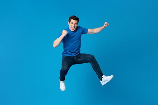 American man jumping and enyoying his success 1166716422