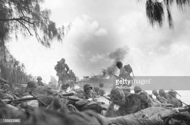 American Marines dig in after a beach landing and prepare to attack Japanese defenders on Saipan, Marianas Islands, Micronesia, July 1, 1944.
