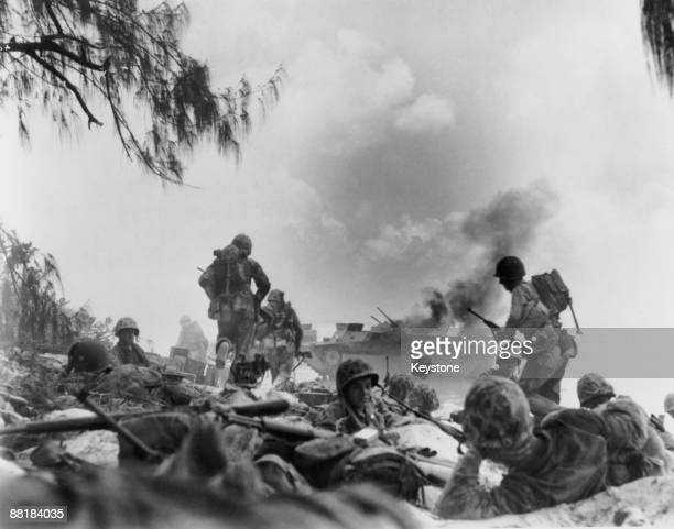 American Marines dig in on a beach on Saipan Island during the Battle of Saipan in the Northern Mariana Islands, June 1944.