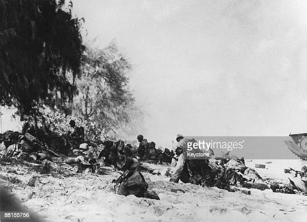 American Marines move from a beach towards high ground in order to attack Japanese defensive positions on Saipan Island during the Battle of Saipan...