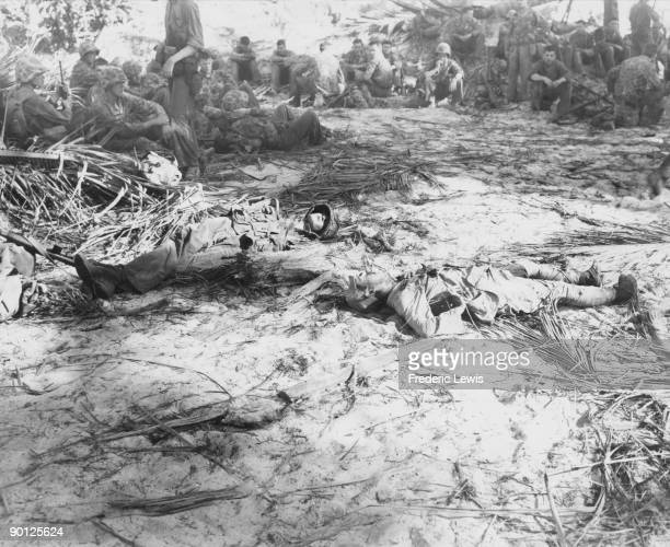 American Marines rest during the Battle of Tarawa a Pacific atoll in the Gilbert Islands 20th23rd November 1943 In the foreground are the dead bodies...