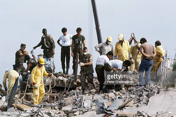 American Marines search for survivors and bodies in the rubble, all that was left of their barracks head quarters in Beirut, after a terrorist...