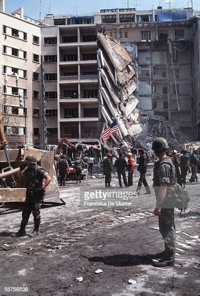 American Marines stand a stunned guard as rescuers examine the wreckage after the suicide truck bombing of the American embassy that killed 63 people...