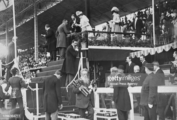 American marksman Walter W Winans is presented with his gold medal by Queen Alexandra won in the men's double-shot running deer event of the 1908...