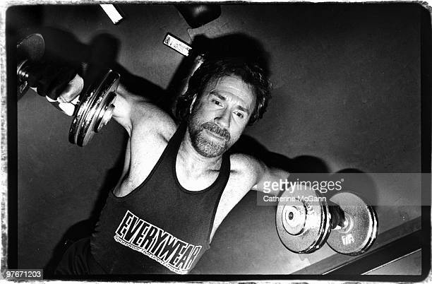 American martial artist and actor Chuck Norris exercises by lifting weights on April 1993 in New York City New York