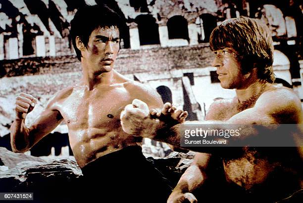 American martial artist Chuck Norris with Chinese American martial artist actor director and screenwriter Bruce Lee on the set of his movie Meng Long...