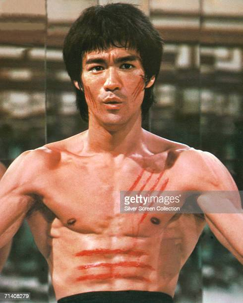 American martial arts star Bruce Lee stars in 'Enter the Dragon' directed by Robert Clouse 1973 Bloody scratches cover his chest and face