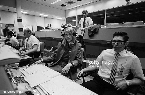 American mathematician and engineer Frances Poppy Northcutt sitting with colleagues Houston Texas US 16th March 1969 She was the first female...