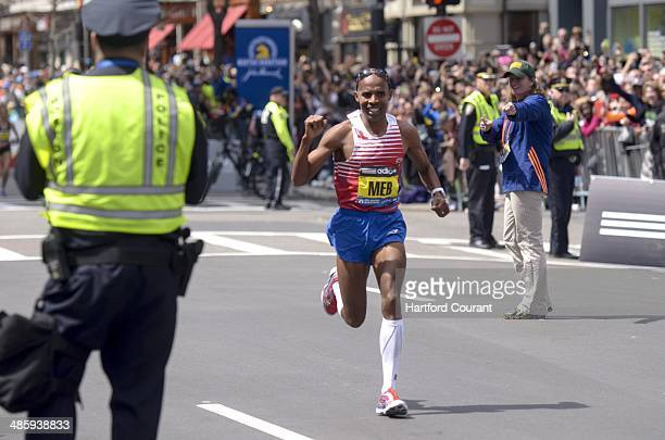 American Meb Keflezighi wins the 118th Boston Marathon a year after deadly bombings near the Marathon finish line in Boston Monday April 21 2014...