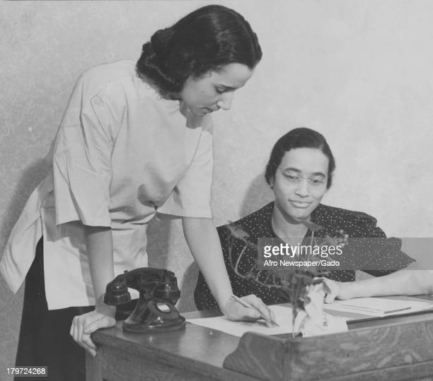 American medical practioner Dr Louise Young discusses plans with Miss Margaret Dorsey secretary at maternity clinic which opened this week at 1523...