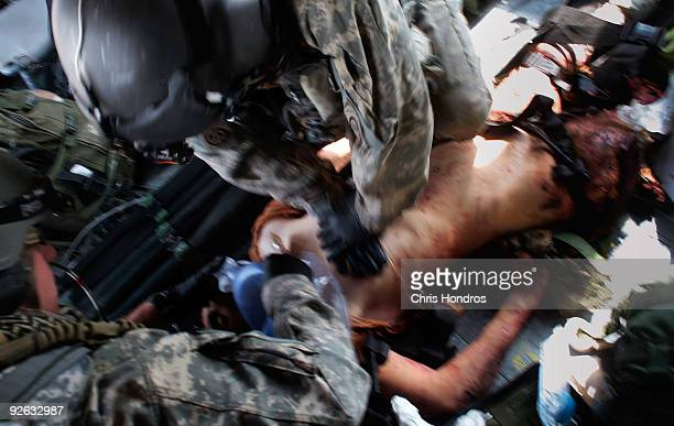 American medics in the 82nd Airborne Combat Aviation Brigade attend to a grievously wounded unidentified Afghan National Army soldier in a Medivac...