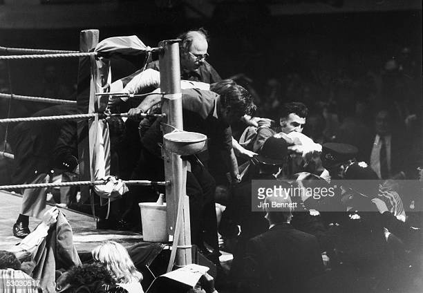 American middleweight boxer Marvin Hagler leaving the ring under police escort after his fight with Alan Minter was stopped in the third round in his...