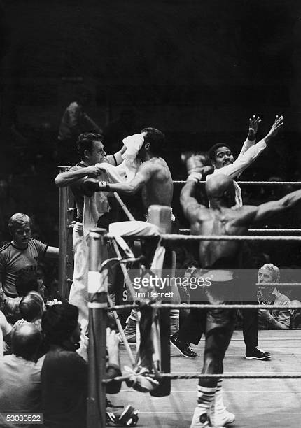 American middleweight boxer Marvin Hagler with arms raised in jubilation after his fight with Alan Minter was stopped in the third round in his...
