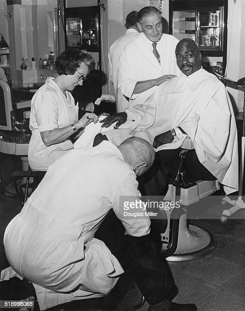 American middleweight boxer Rubin 'Hurricane' Carter in the barber's shop at the Cumberland Hotel London 25th February 1965 Carter has just held a...