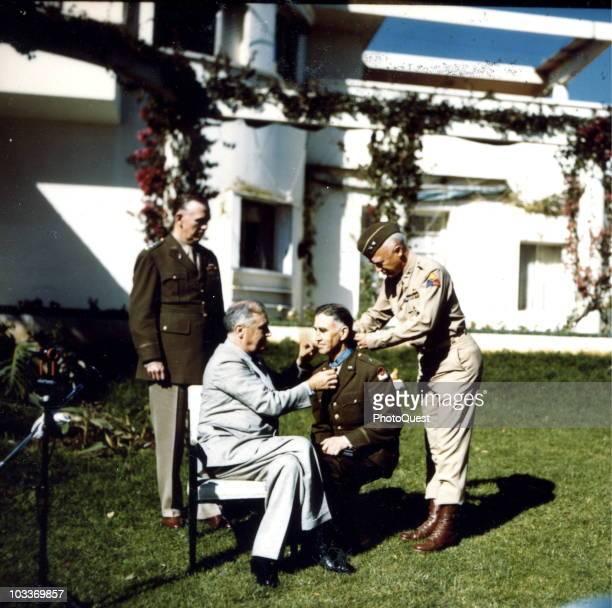 American military commander Brigadier General William Hale Wilbur kneels to receive the Medal of Honor from American President Franklin Delano...