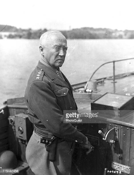 American military commander General George S Patton Commander of the US 3rd Army pilots a motor launch on Lake Attersee near Salzburg Austria May 19...