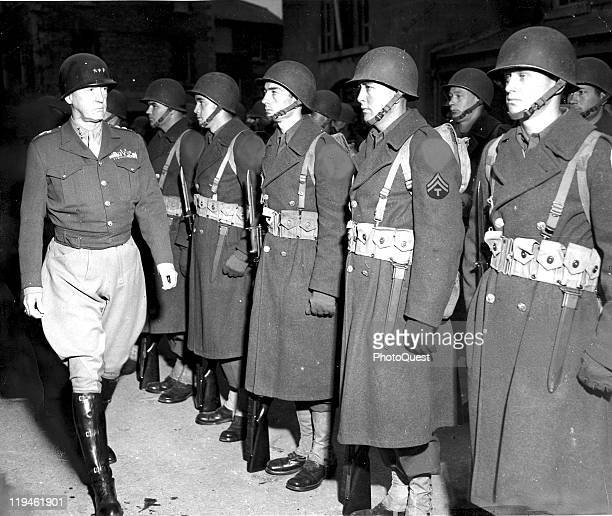 American military commander Lieutenant General George S Patton inspects troops of a unit in his command April 26 1944 Note that the soldier's unit...