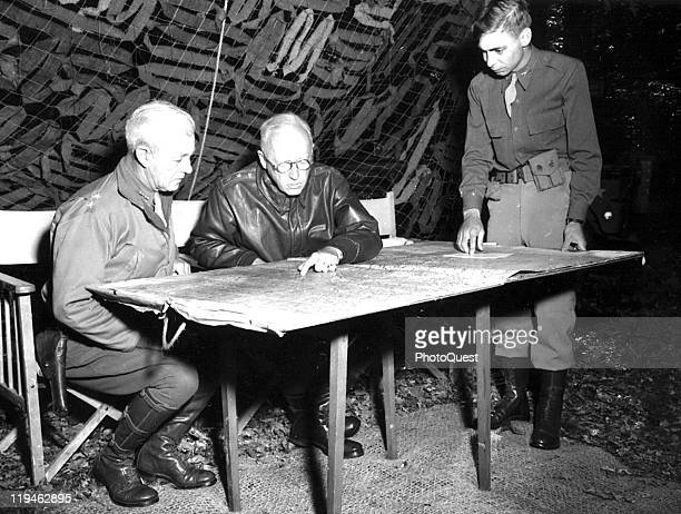 American military commander Lieutenant General George S Patton Commander of the US 3rd Army conferes with Chief of Staff Major General Hugh Gaffney...