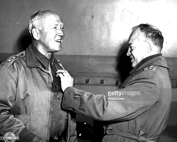 American military commander Lieutenant General George S. Patton smiles as he receives his third star from General Dwight D. Eisenhower , March 12,...