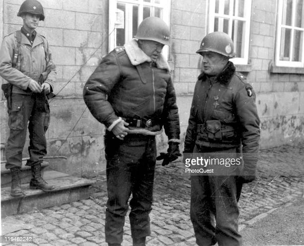 American military commander Lieutenant General George S Patton talks with Brigadier General Anthony McAuliffe Bastogne France December 28 1944...