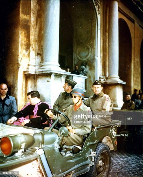 American military commander Lieutenant General Mark W Clark and Major General Alfred M Gruenther of the US 5th Army ride with American Monsignor...