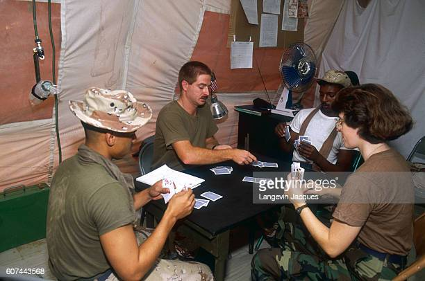 American military personnel play cards the operating room of a US field hospital in Dharan Saudi Arabia | Location Dharan Saudi Arabia