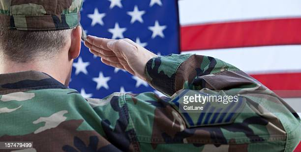 american military salute against us flag - saluting stock pictures, royalty-free photos & images