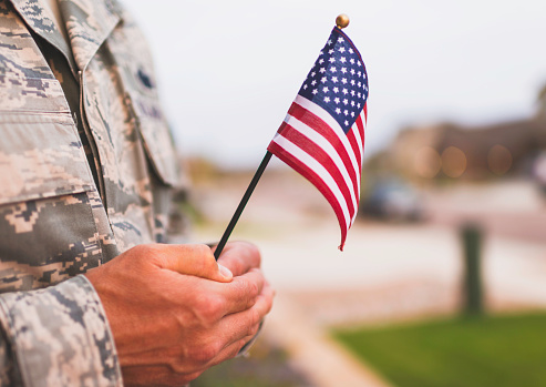 American military soldier with flag. Patriotic theme 844191110