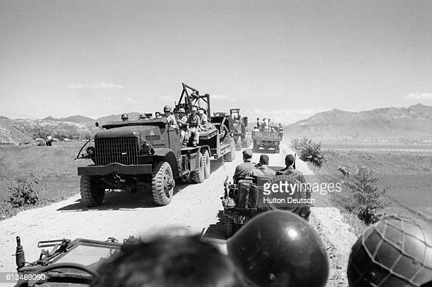 American Military Units On The Road To The Front Near Taejon. Following the crossing of the 38th parallel by North Korean troops and the United...