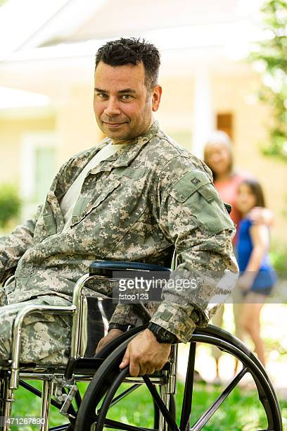 american military veteran welcomed home by family. wheelchair, disabled. home. - paraplegic stock photos and pictures