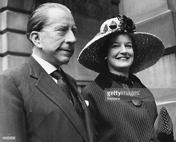 American millionaire J Paul Getty and his English solicitor Robina Lund arriving at Burlington House London for a private view of the Royal Academy...