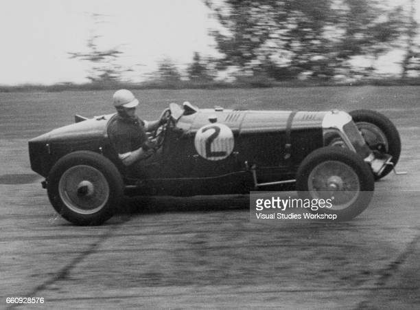 American millionaire Whitney Straight races a Maserati at Brooklands Brooklands England May 26 1932 Though new to auto racing Straight set a lap...