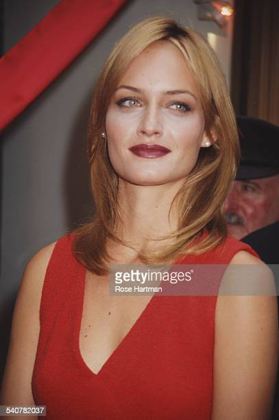 American model Amber Valletta attends the launch of the new Elizabeth Arden perfume '5th Avenue' at the opening of the Fifth Avenue Photo Gallery in...