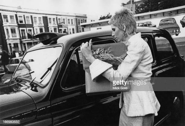 American model and actress Angie Bowie arrives at the Earl's Court Exhibition Centre London before a concert by her husband David Bowie on his Ziggy...