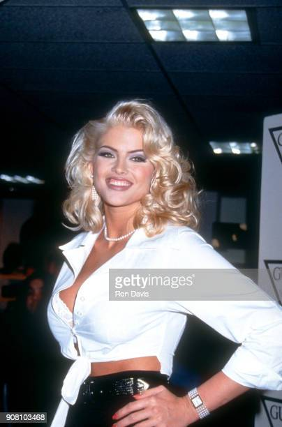American model and actress Anna Nicole Smith poses for Guess Sportswear on February 20 1993 at the Bullock's Store at Beverly Center in Beverly Hills...