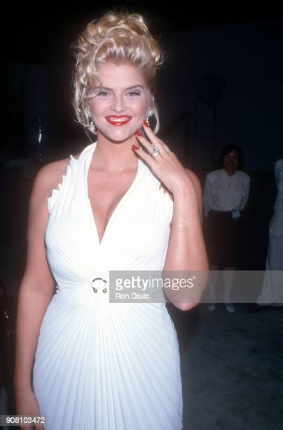 American model and actress Anna Nicole Smith shows off the wedding ring given to her by billionaire J Howard Marshall while she attends the 1994...