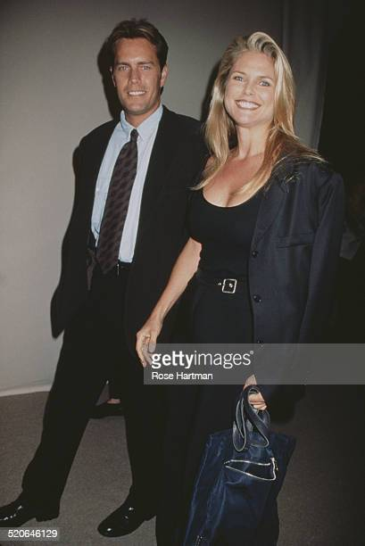 American model and actress Christie Brinkley with her husband architect Peter Cook at the Giorgio Armani party at The Armory New York City USA 1996