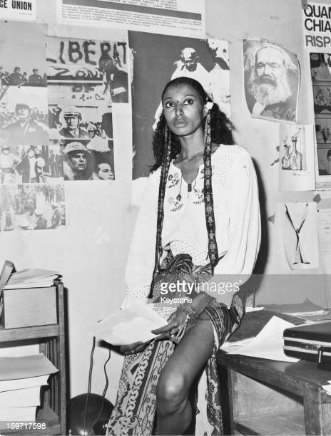 American model and actress Donyale Luna in Italy 1973 On the wall behind her are pictures of Mahatma Gandhi and Karl Marx