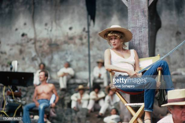 American model and actress Lauren Hutton sits in a director's chair a sword in her lap on the set of her film 'Zorro the Gay Blade' Mexico 1980