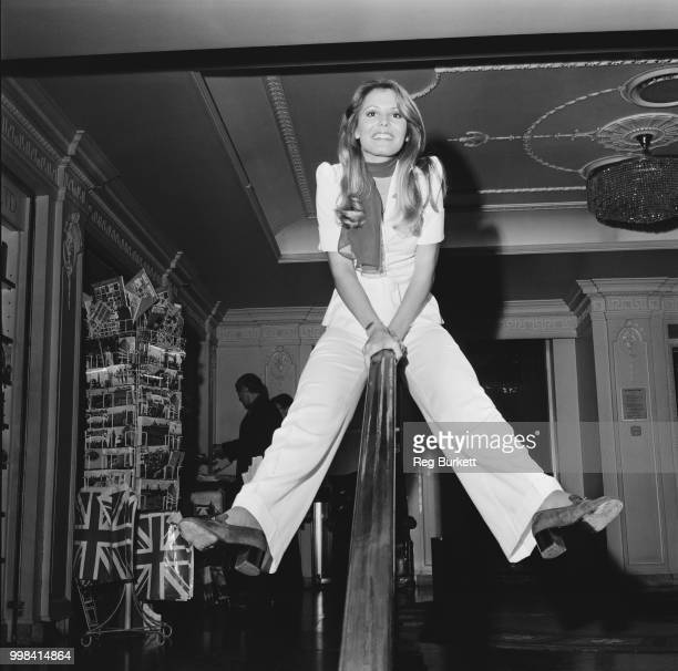 American model and beauty queen Marjorie Wallace recently crowned Miss World 1973 at the Royal Albert Hall pictured sitting astride a bannister at a...