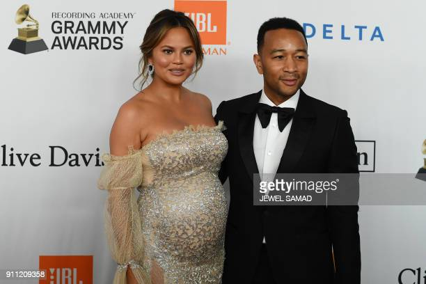 American model and future mom Chrissy Teigen and Singer John Legend arrive for the traditionnal Clive Davis party on the eve of the 60th Annual...
