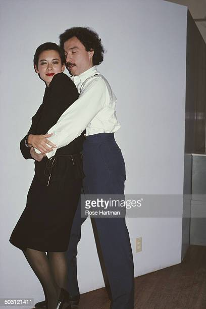 American model and jewellery designer Tina Chow and fashion illustrator Antonio Lopez in Antonio's studio 1980