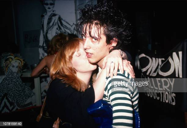 American model and magazine editor Rusty Hamilton kisses Punk musician Howie Piro of the group the Blessed at the Nonson Gallery New York New York...