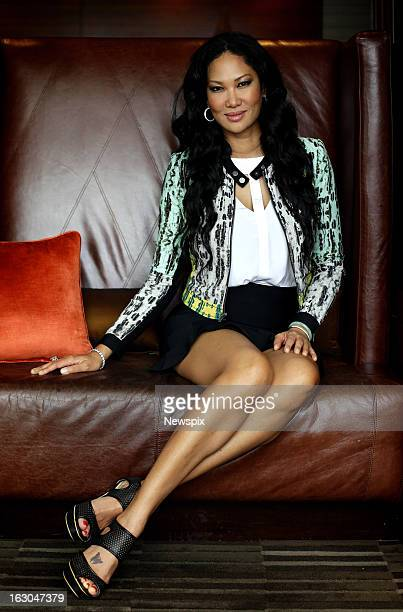 American model and television personality Kimora Lee Simmons poses during a portrait shoot at the Sheraton on the Park Hotel on February 28 2013 in...
