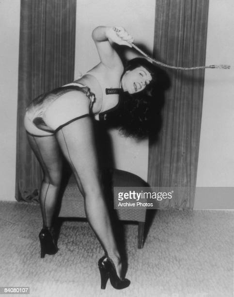 American model Bettie Page whips herself into frenzy circa 1955